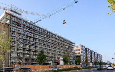 Quartier Heidestrasse wächst weiter: Richtkranz schwebt über QH Spring